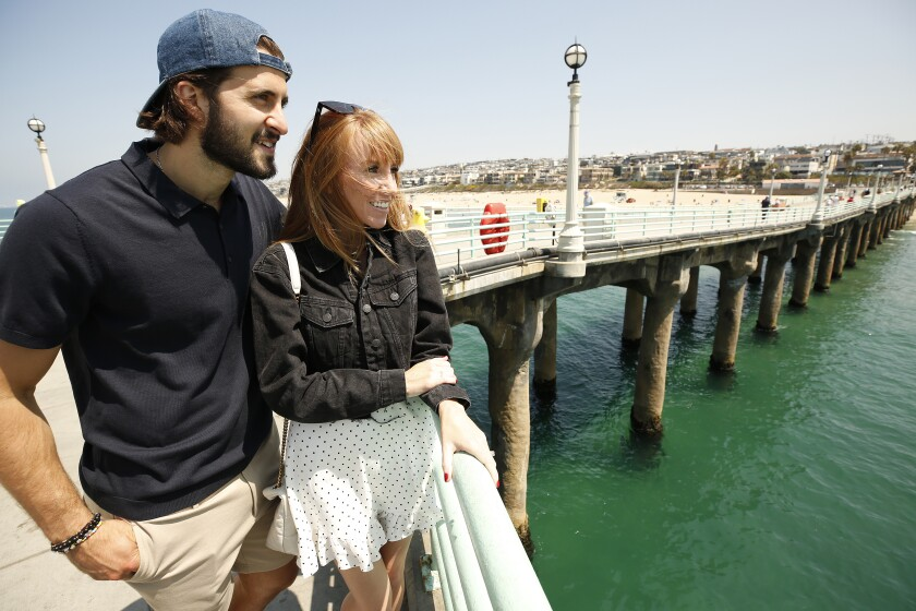 Kings center Phillip Danault and his wife Marie get a tour of the Manhattan Beach Pier.
