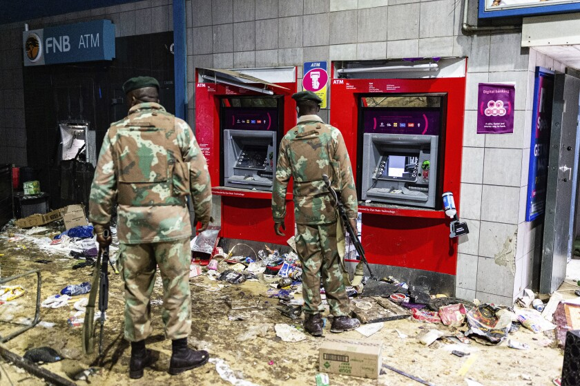 Soldiers in front of damaged ATM