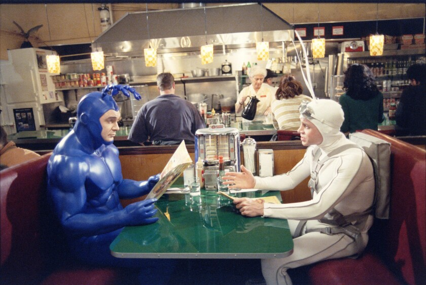 """Patrick Warburton, left, as the Tick, and David Burke as Arthur in the short-lived series """"The Tick"""" on Fox. Amazon has recently announced an order for a new live-action pilot based on the Ben Edlund comics character."""