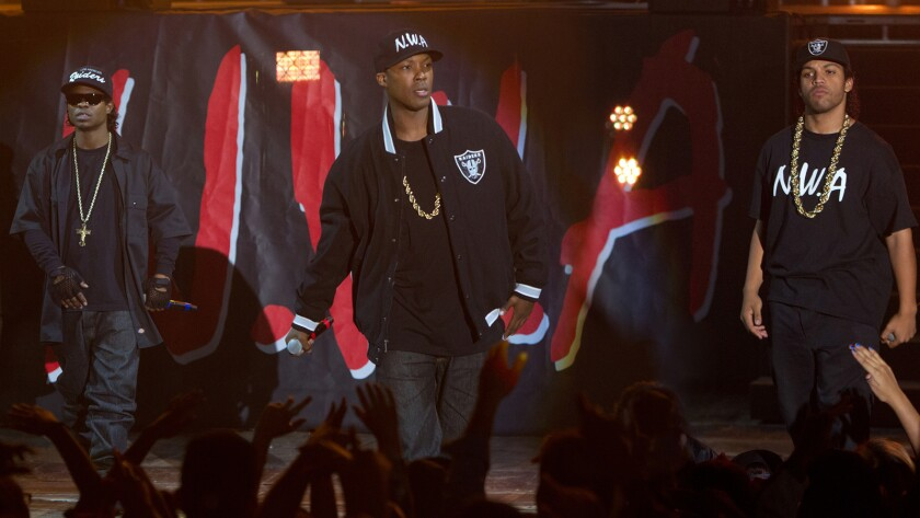 """N.W.A members Eazy-E (Jason Mitchell), from left, Dr. Dre (Corey Hawkins) and Ice Cube (O'Shea Jackson Jr.) take center stage in """"Straight Outta Compton."""""""