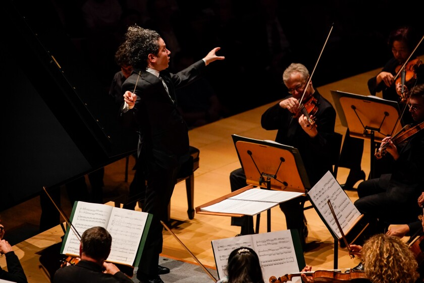 Gustavo Dudamel conducts the Los Angeles Philharmonic in the world premiere of Esteban Benzecry's Piano Concert with pianist Sergio Tiempo at Walt Disney Concert Hall on Thursday.