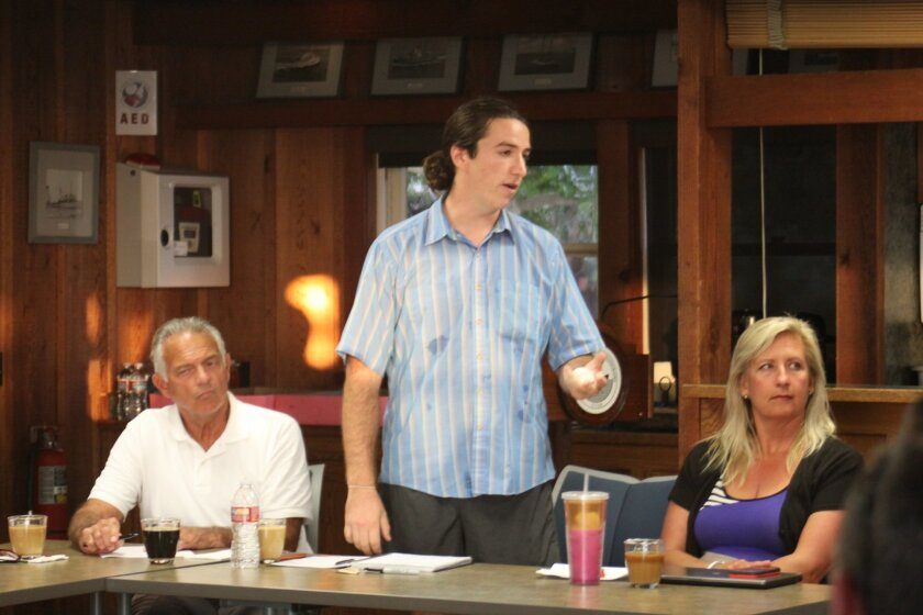At the LJSA meeting, Café Solange owner Christian Malecot says his restaurant will offer takeout while Avenida de la Playa is under construction.