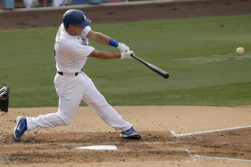 Los Angeles Dodgers' Austin Barnes hits a single to center field against the Seattle Mariners.