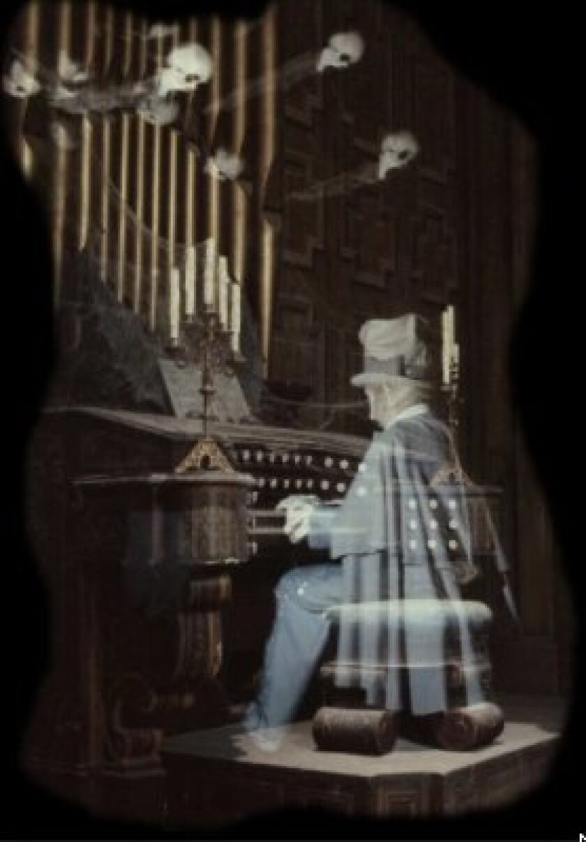 Ghostly apparitions appear at the pipe organ built by Disney Imagineer Rolly Crump for the Haunted Mansion ride at Disneyland, which marks its 50th anniversary on Aug. 9, 2019. Crump also co-created with Yale Gracey the special effect that created the see-through ghosts.