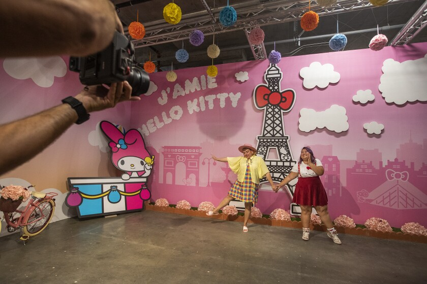 Darlene Sritapan, left, and Karen Pagtama strike a pose inside the Paris room at the Hello Kitty Friends Around the World Tour pop-up.