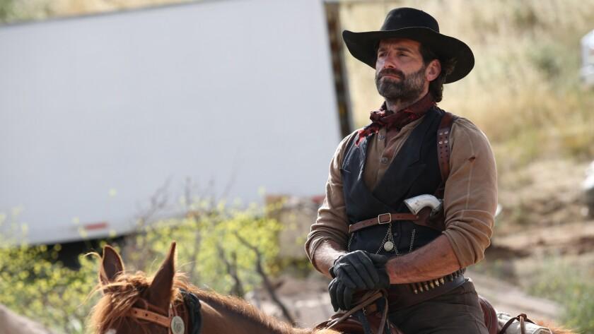 Kevin Makely on horseback in the movie 'Badland'