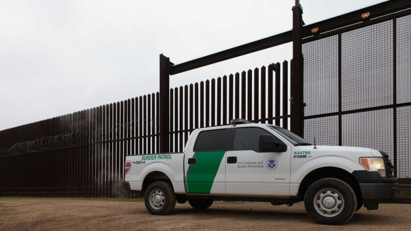A U.S. Customs and Border Protection vehicle drives at the gate of the fence at the U.S.-Mexico border in McAllen, Texas, on Jan. 15.