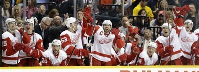 Detroit Red Wings players, including Cory Emmerton (25), Gustav Nyquist (14), Drew Miller (20), Joakim Andersson (63), Henrik Zetterberg (40) and Damien Brunner (24), celebrate after Johan Franzen, not shown, scored against the Nashville Predators in the third period of an NHL hockey game, Sunday,