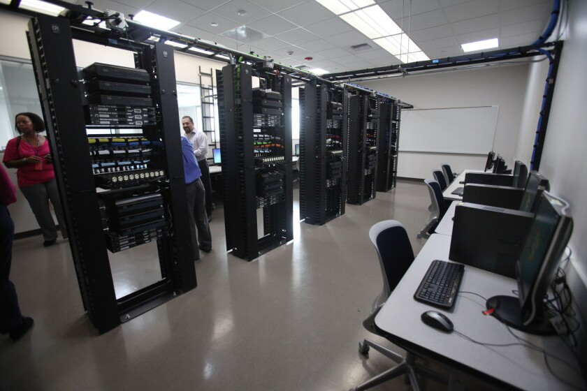 Visitors to the new campus toured the computer lab.