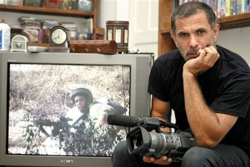 In this photo taken Tuesday, July 27, 2004, Israeli Palestinian actor, director, filmmaker and political activist Juliano Mer-Khamis poses for a photograph in his home in the northern Israeli city of Haifa. Mer Khamis was shot five times by one or more militants in the West Bank city of Jenin Monday, according to Jenin police chief Mohammed Tayyim. There was no immediate claim of responsibility. (AP Photo/Alex Rozkovsky) ISRAEL OUT