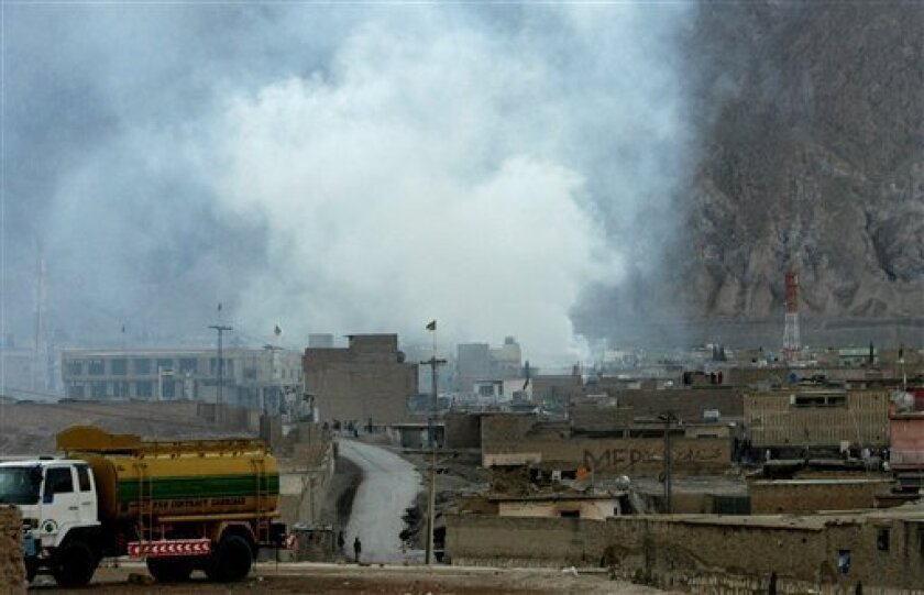 Smoke rises from the site of a bomb blast in a market in Quetta, Pakistan on Saturday, Feb. 16, 2013. Senior police officer Wazir Khan Nasir said the bomb went off in a Shiite Muslim-dominated residential suburb of the city of Quetta. Residents rushed the victims to three different hospitals.(AP Ph