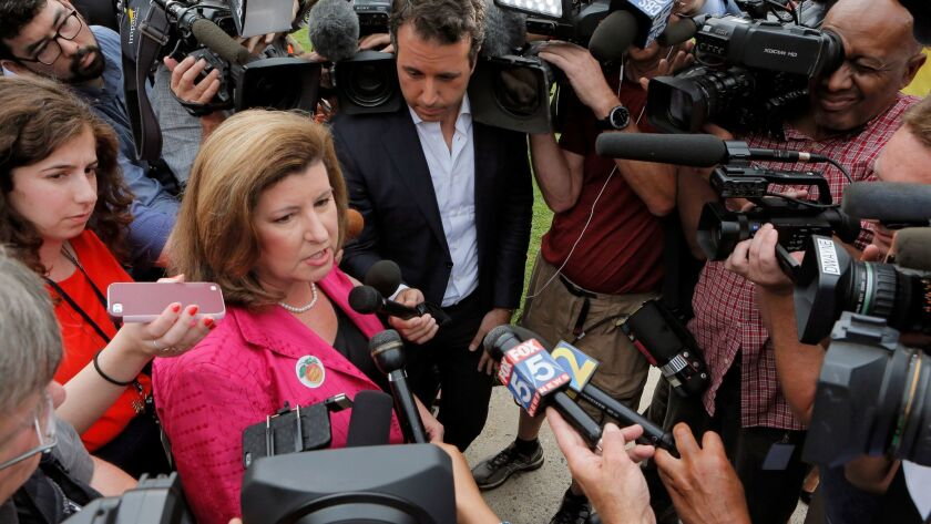 Karen Handel, Republican candidate for Congress, talks to the press Tuesday, June 20, 2017, after sh