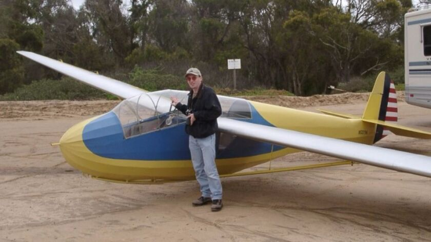 Gary Fogel, historian for the Associated Glider Clubs of Southern California, poses with a motorless