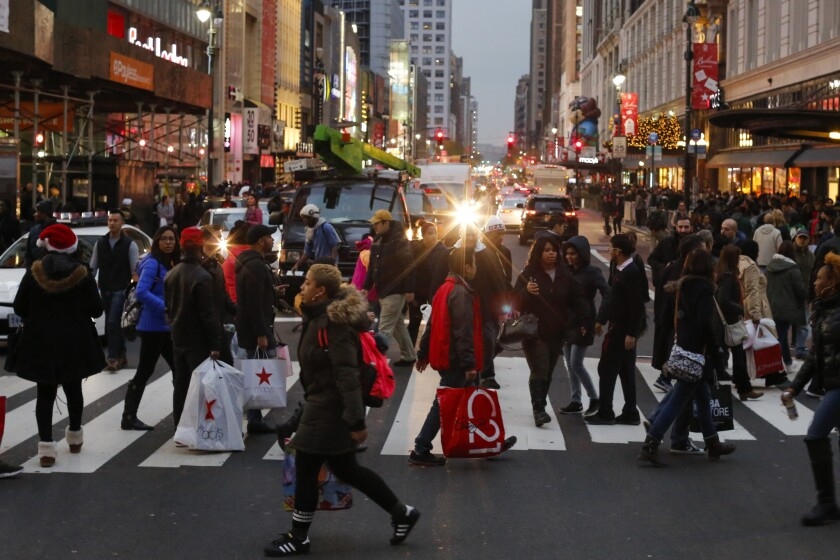 People carry retail shopping bags during Black Friday events on November 25, 2016 in New York City. T
