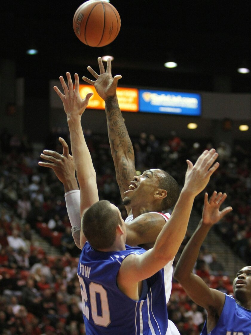 Malcolm Thomas drives for a layup in the first half as Air Force's Tom Fow defends.