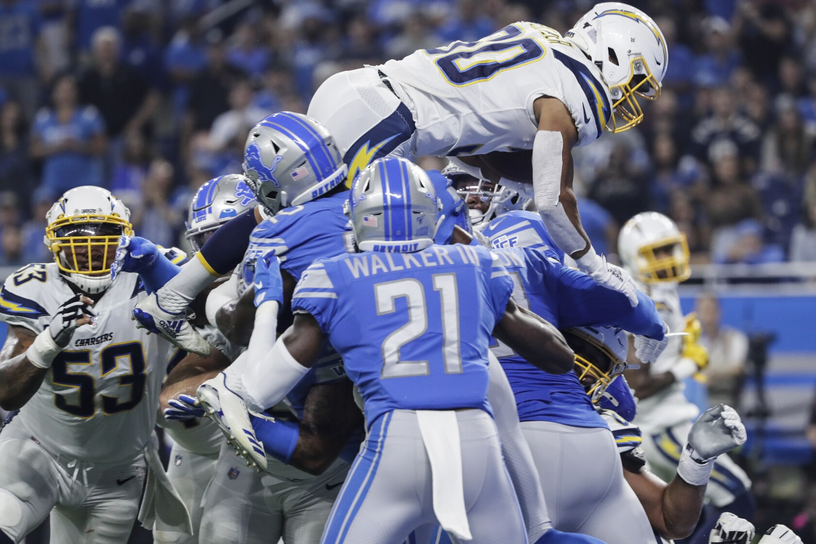 Missed field goals, penalties and turnovers prove costly in Chargers' loss to Lions