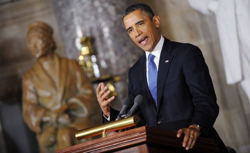 President Obama speaks at the unveiling of a Rosa Parks statue at the Capitol in Washington.