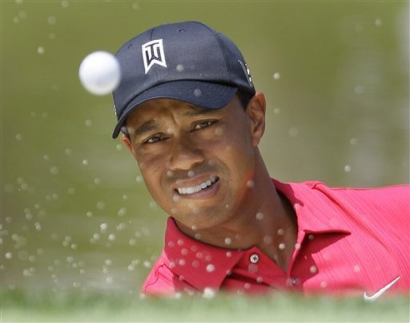 Tiger Woods hits from the bunker to the third green in the fourth round of the Memorial golf tournament at Muirfield Village Golf Club on Sunday, June 6, 2010, in Dublin, Ohio. (AP Photo/Amy Sancetta)