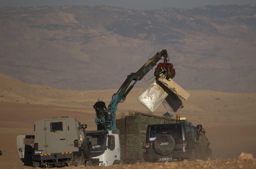 Israeli forces demolish tents and other structures belong to Bedouins at the Khirbet Humsu hamlet in Jordan Valley in the West Bank, Wednesday, July 7, 2021. Israel on Wednesday, demolished the Bedouin herding community of Khirbet Humsu in the occupied West Bank, the latest chapter in the military's attempts to uproot the Palestinian village of makeshift home. (AP Photo/Majdi Mohammed)
