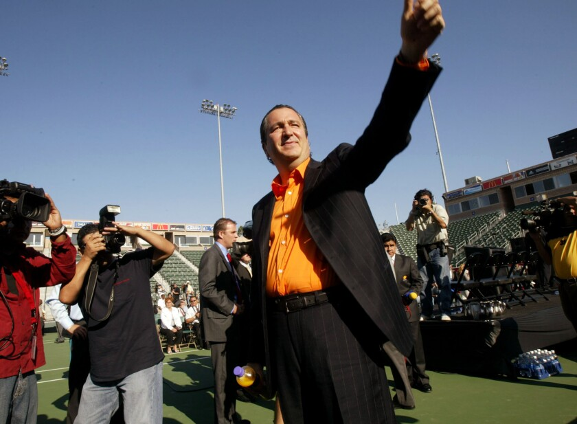 In this Aug. 2, 2004, file photo, Jorge Vergara waves to fans at a news conference in Carson.