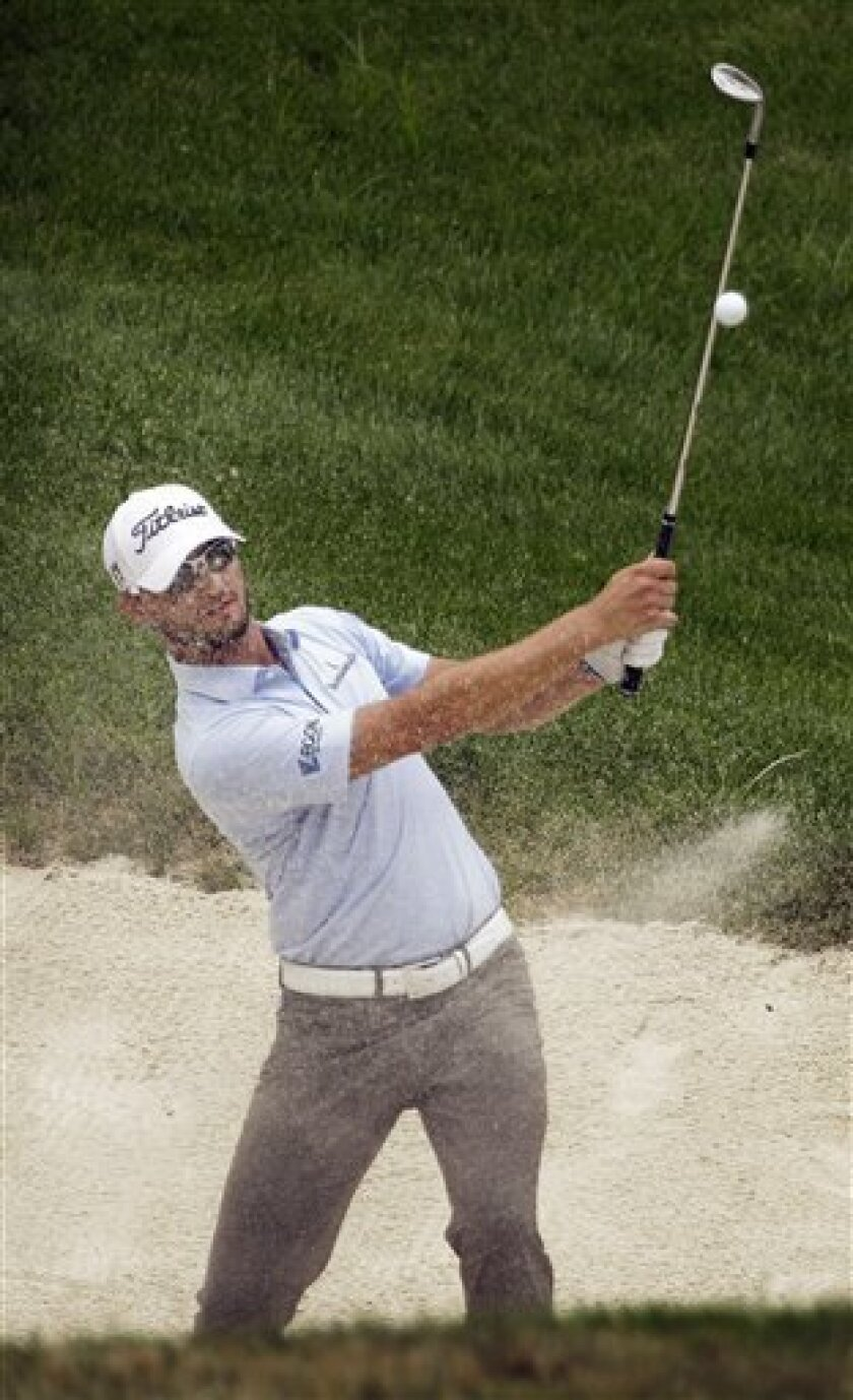 Kyle Stanley hits out of a bunker on the eighteenth green during the final round of the John Deere Classic golf tournament at TPC Deere Run Sunday, July 10, 2011, in Silvis, Ill. (AP Photo/Charlie Neibergall)