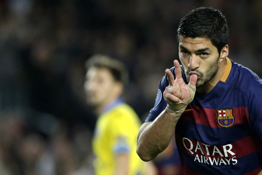 Barcelona's Luis Suarez celebrates after scoring during the Champions League Group E soccer match between FC Barcelona and BATE Borisov at the Camp Nou stadium in Barcelona, Spain, Wednesday, Nov. 4, 2015. (AP Photo/Emilio Morenatti)