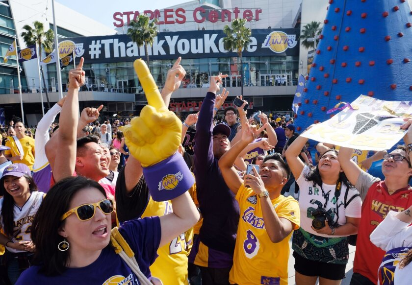 Fans celebrate outside Staples Center as Kobe Bryant prepares to play his last NBA basketball game, a contest against the Utah Jazz, in downtown Los Angeles Wednesday, April 13, 2016. Many of BryantGÇÜ+ä+¦s fans - even some of the adults - have never known Los Angeles without him. ItGÇÜ+ä+¦s a feeling theyGÇÜ+ä+¦re about to have to get used to as fans celebrate his final night as a Laker.