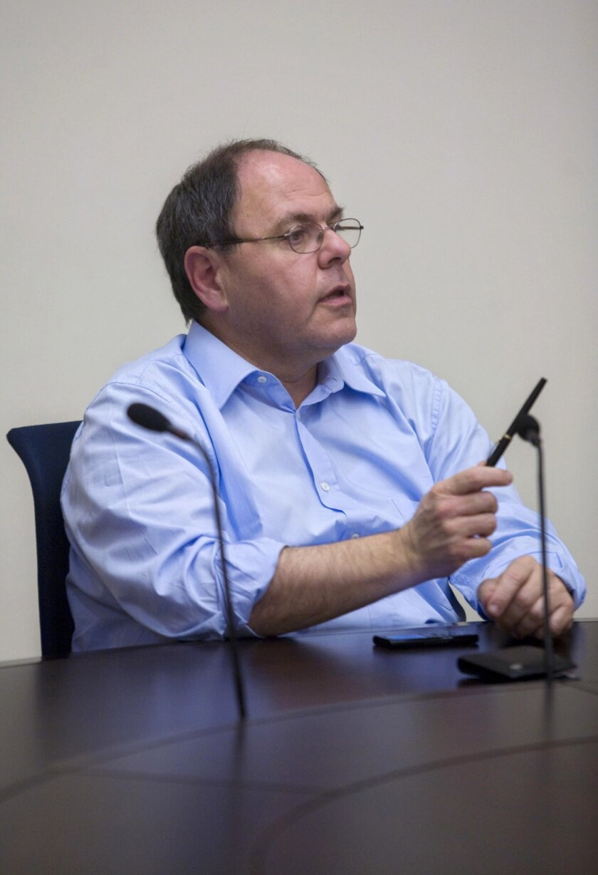 FILE - In this Dec. 21, 2009, file photo, former Chairman of the Yesha Council Dani Dayan, speaks, during a meeting at the Knesset, Israel's parliament in Jerusalem. In a landmark test case for Israel, the appointment of Dayan as its next ambassador to Brazil is suddenly in trouble due to his ties to the West Bank settlement movement. Brazil has reportedly expressed objections to the appointment of Dayan, raising questions about when or even if he will take up the post. (AP Photo/Olivier Fitoussi, File)