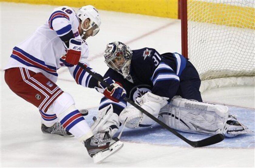 Winnipeg Jets goaltender Ondrej Pavelec (31) stops New York Rangers forward Marian Gaborik (10) on the breakaway during the first period of their NHL hockey game, Thursday, March 14, 2013,in Winnipeg, Manitoba. (AP Photo/The Canadian Press, John Woods)