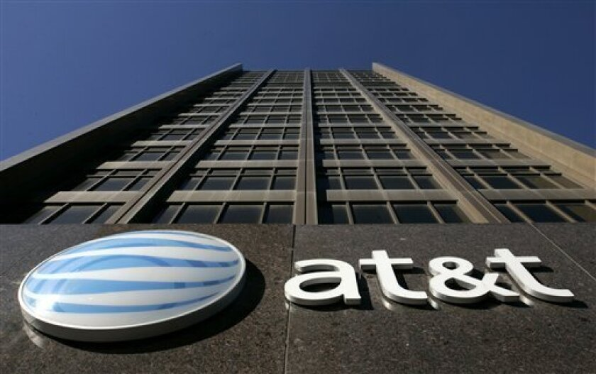 FILE - In this Jan. 25, 2007 file photo, the AT&T Michigan headquarters is shown in Detroit. AT&T Inc. on Sunday, March 20, 2011 said it will buy T-Mobile USA from Deutsche Telekom AG in a cash-and-stock deal valued at $39 billion, becoming the largest cellphone company in the U.S. (AP Photo/Paul Sancya, File)