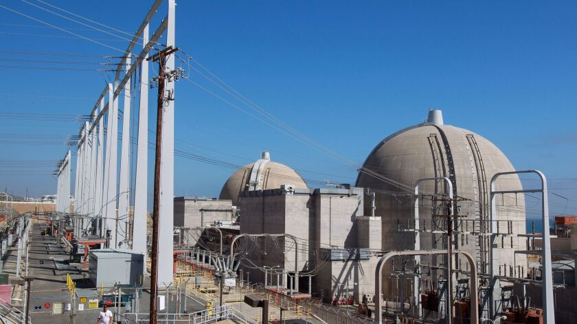With transmission lines at left, Unit 2, right, and Unit 3 reactor containment structures at the San Onofre Nuclear Generating Station.