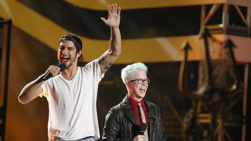 Tyler Posey, left, and Tyler Oakley take the stage during the mtvU Fandom Awards. (Hayne Palmour IV / UT San Diego)