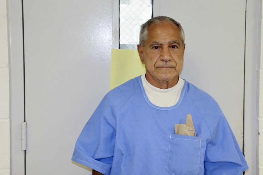 Sirhan Sirhan arrives for a parole hearing Friday, Aug. 27, 2021, in San Diego. He is wearing a blue prison-issued shirt.