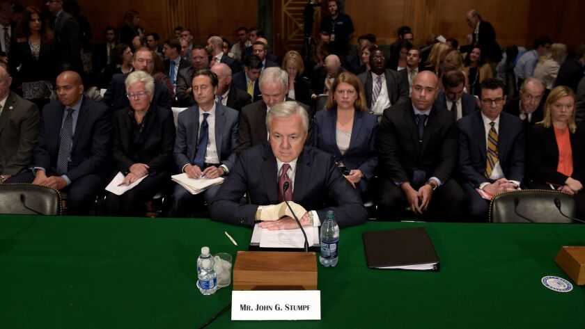 FILE - In this Sept. 20, 2016 file photo Wells Fargo Chief Executive Officer John Stumpf prepares to