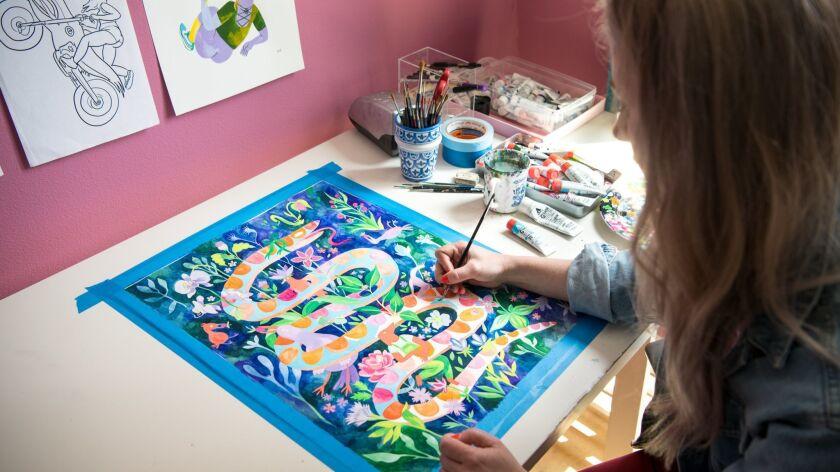 LOS ANGELES, CA - APRIL 26, 2019: Illustrator and TV producer Lisa Hanawalt paints in her studio. Ha