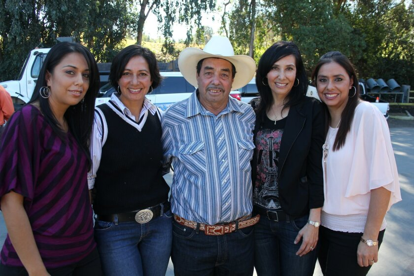 Olimpio Rodriguez and his daughters Marcela, Alma, Silvia and Maria.