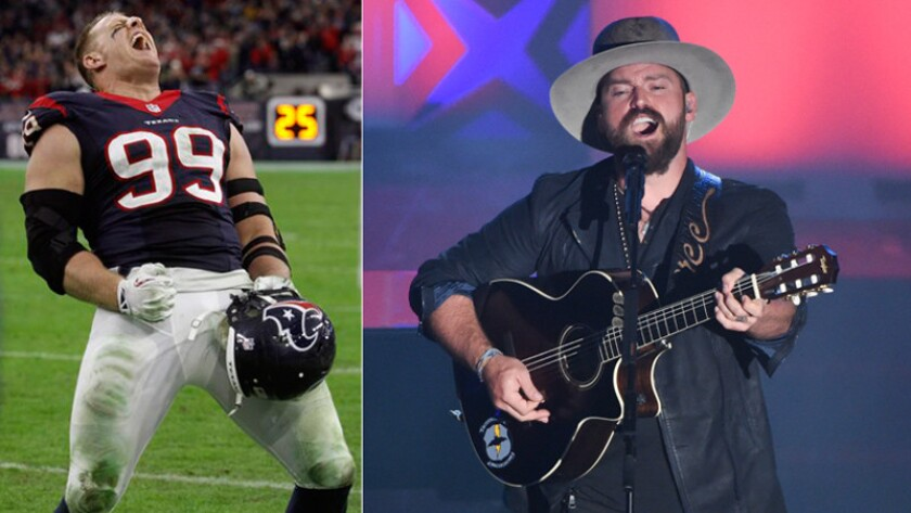 The NFL's J.J. Watt, left, did Zac Brown and his band a favor Sunday night in Milwaukee, tackling a stage-jumper during the concert. Staged or not, it's comedy.