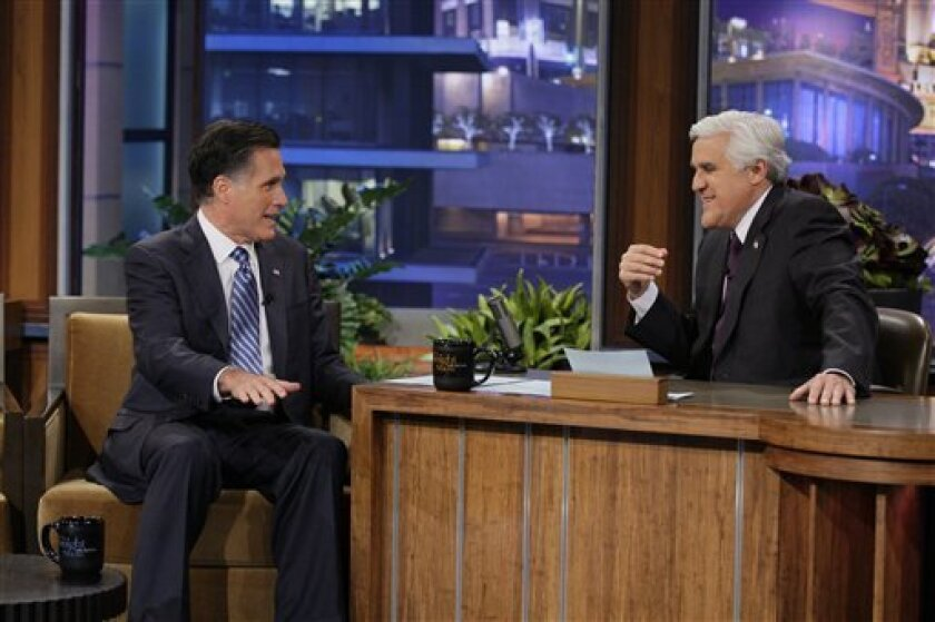 In this photo provided by NBC, Republican presidential candidate, former Massachusetts Gov. Mitt Romney talks with Jay Leno during his appearance on The Tonight Show in Burbank, Calif., Tuesday, March 27, 2012. Romney cracked Tuesday night that he'd pick Leno rival David Letterman as his vice presi