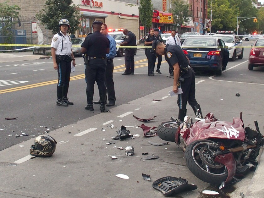 NYPD Brooklyn Highway Officers investigate the scene where one man died and four others — including a child — were hospitalized Saturday following a horrific crash between a car and a motorcycle in Brooklyn.