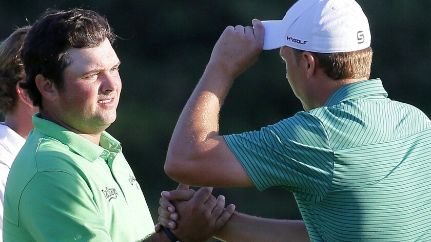 Patrick Reed, left, congratulates Jordan Spieth after the first round of the Tournament of Champions golf tournament Thursday.