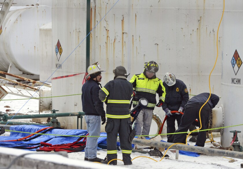 Investigators with the FBI and local fire departments inspect the Freedom Industries site in West Virginia in January.