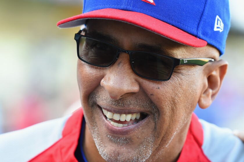 Manager for Team Puerto Rico, Edwin Rodriguez, smiles before 2017 World Baseball Classic game at Dodger Stadium.