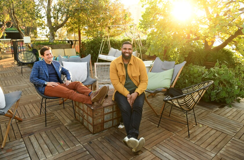 Joe Green and Prophet Walker sit in the rooftop garden at Treehouse