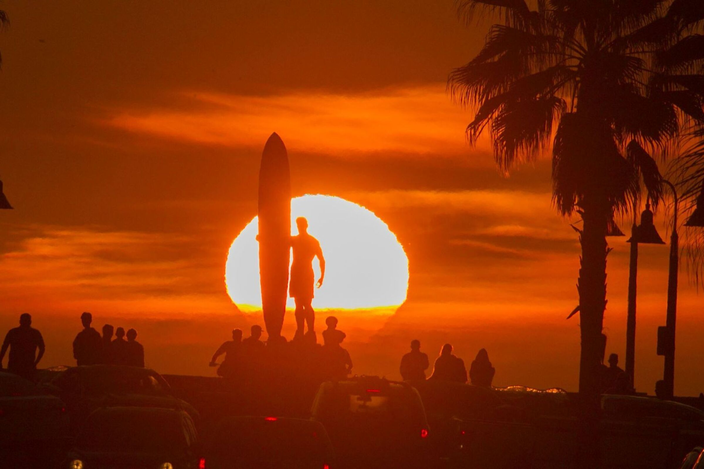 "A sunset perfectly lined up with Palm Avenue in Imperial Beach and the ""Spirit of Imperial Beach"" statue."