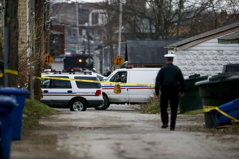 Columbus Police block an alley near 6th Avenue and Cortland Avenue in Columbus, Ohio while investigating the scene where the body of missing Ohio State football player, Kosta Karageorge was discovered in a dumpster on Nov. 30, 2014. According to police, Karageorge died of a self-inflicted gunshot wound. (AP Photo/The Columbus Dispatch, Kristen Zeis)