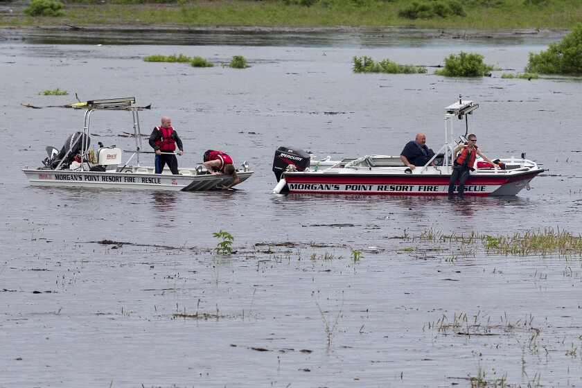 FILE - In this June 2, 2016 file photo, Morgan's Point Resort Fire and Rescue works on Lake Belton near the scene of an accident at Fort Hood at Owl Creek Park near Gatesville, Texas. Army officials have decided not to publicly release findings of the official investigation report on the 2016 Fort Hood training accident during flash flooding that killed eight soldiers and a West Point cadet. The Killeen Daily Herald filed Freedom of Information Act requests for the accident report conducted by the U.S. Army Combat Readiness Center at Fort Rucker, Alabama. The nine military personnel died when their truck overturned while crossing Fort Hood's Owl Creek. (Michael Miller/The Temple Daily Telegram via AP, File)
