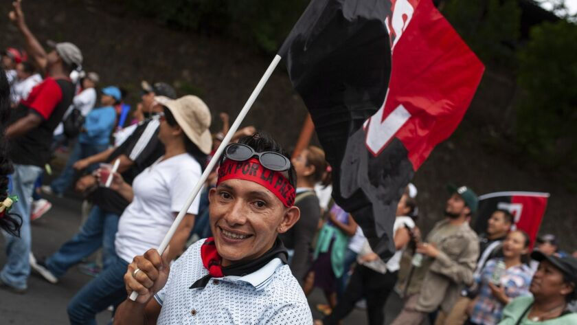 A Sandinista supporter smiles to the camera during a march to support Nicaraguan President Daniel Or