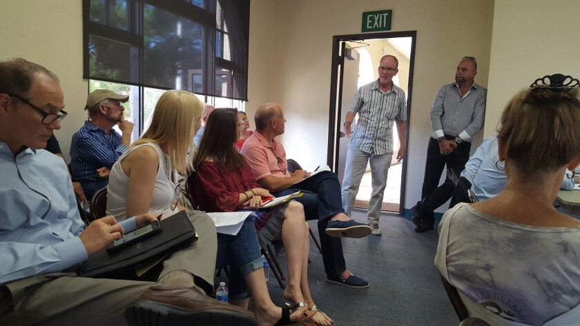 Neighbors speak out against the project as proposed