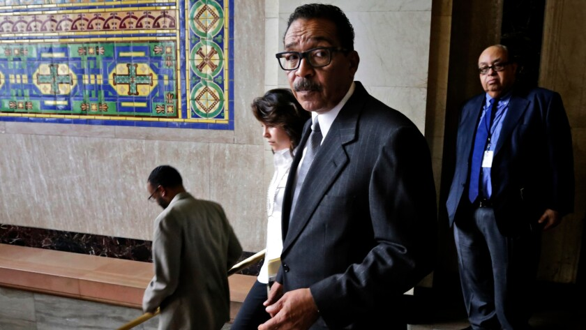 Los Angeles City Council President Herb Wesson leaves a press conference after addressing the media about the speaker card submitted by Wayne Spindler.