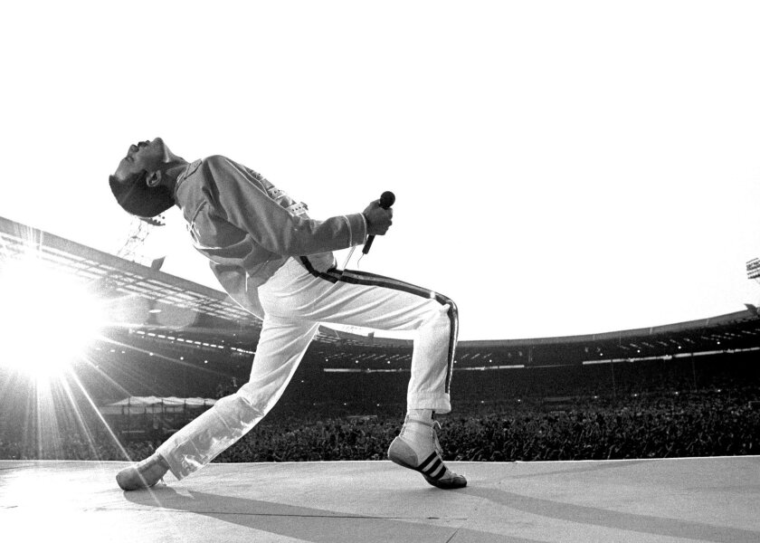 Freddie Mercury of Queen is shown on stage at London's Wembley Stadium in 1986. Neal Preston, who took this iconic photo, had a close relationship with the band.